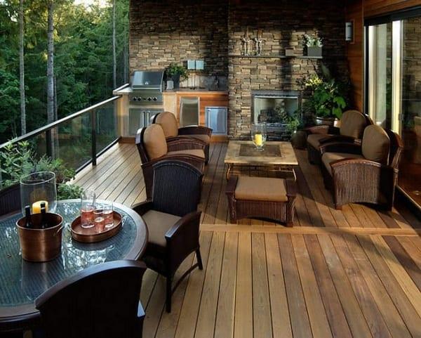 moderne berdachte terrasse mit holzboden und natursteinwand freshouse. Black Bedroom Furniture Sets. Home Design Ideas