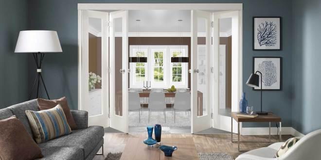 modernes wohnzimmer blau mit falt-innentüren weiß - fresHouse