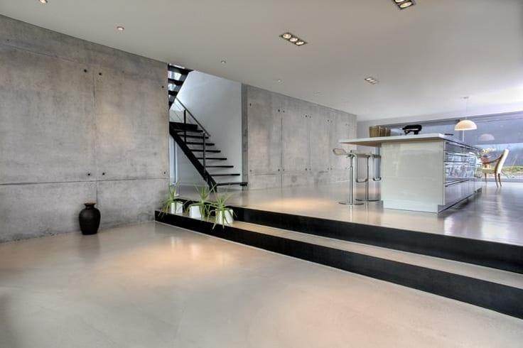 Betonbau mit modernem interior open space wohnung mit for Bilder moderne wohnung design
