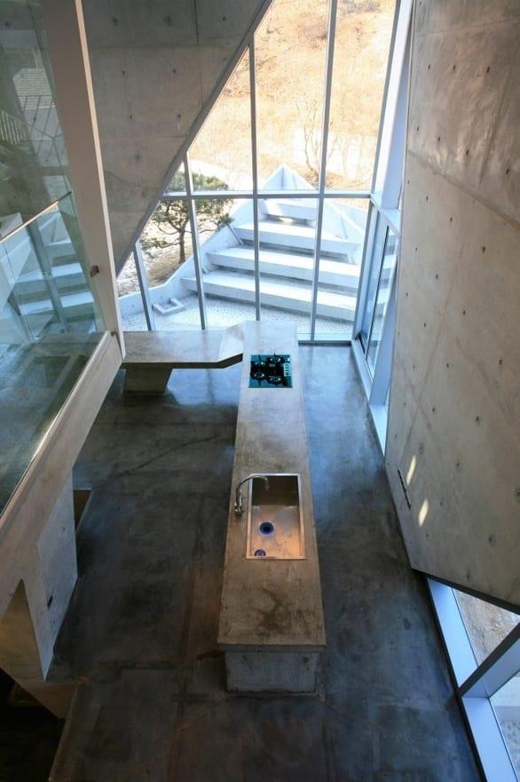 moderne küche mit kochinsel aus beton-luxus betonbau - fresHouse