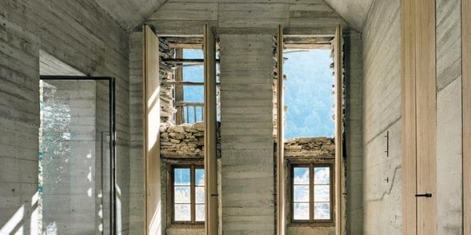 Innenraum aus Beton versteckt im alten Steinbau