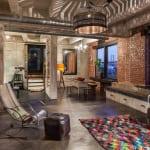 loft Appartement mit luxus wohnzimmer interior aus Ziegeln und DIY Holzregalen weiß