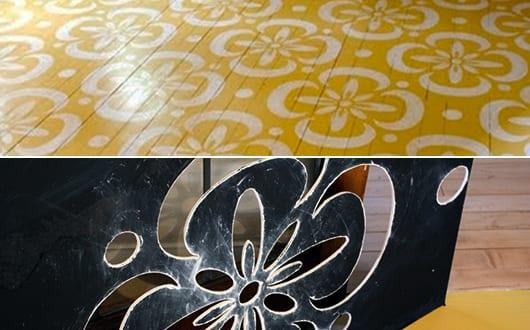Holzboden in gelb streichen mit weißen blumenmotiven