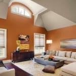 moderne wohnzimmer interior und farbgestaltung mit wandfarbe orange