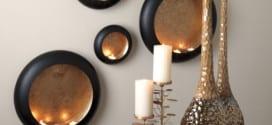 wohnzimmer wandgestaltung mit schwarzen kerzenhaltern rund