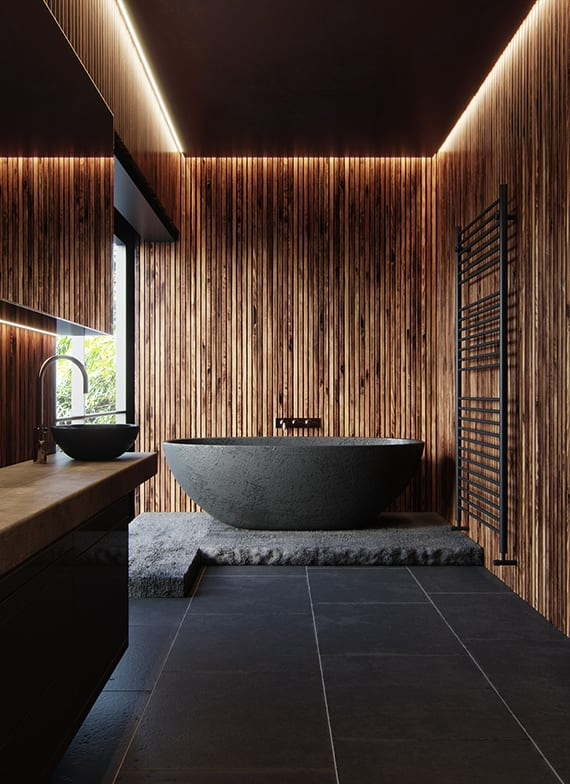 luxus bad im asiatischen stil mit wandverkleidung aus holzlatten, platzsparendem waschtischschrank mit rundem waschbecken, freistehender badewanne schwarz auf betonpodest, badezimmer beleuchtung mit tageslicht und deckeneinbauleuchten