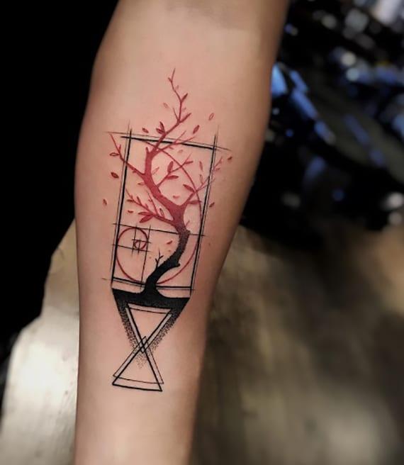 kreative unterarm baum geometric watercolor tattoo in schwarz und rot
