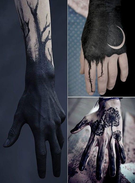 mutige schwarze tattoos hand als blackout-tätowierungen mit mond, blumen oder baum-muster