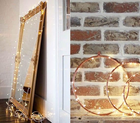 attraktive zimmerdekoration und effektvolle lichtgestaltung mit LED-lichterkette, antike ganzkörperspiegel im goldenen rahmen und metallringen aus kupfer