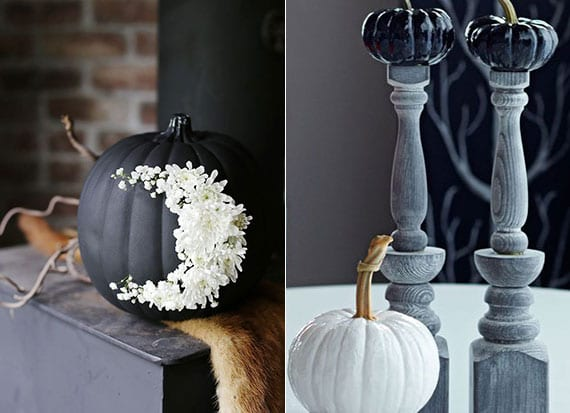 attraktive kürbisdeko ideen mit schwarz gefärbten zier- und speisekürbissen, weißen blumen und holzkerzenständer grau