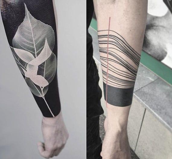 schwarze tattoos für man unterarm als blackout tattoo mit baumblättern und armband-tattoo