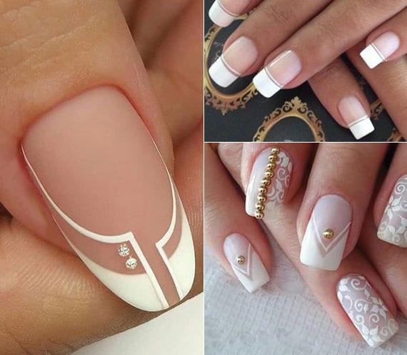 coole nagelgestaltung im französischen stil mit schmucksteinen und weißen blumen-motiven