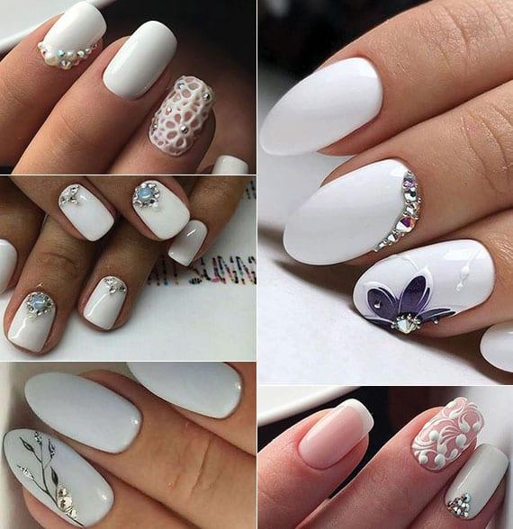 weiße nägel effektvoll dekorieren mit perlen, schmucksteinen und einzelnen blumenmotiven