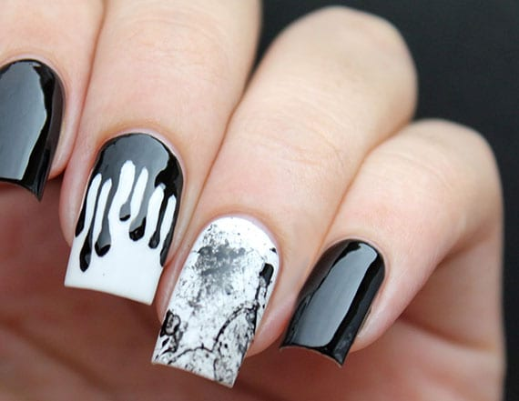kreative gestaltung weißer nägel mit schwarzem Farbkleks-Design