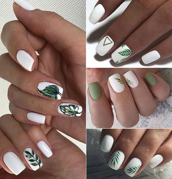 weiße nägel mit grünen bläter-motiven für eine attraktive sommer-maniküre