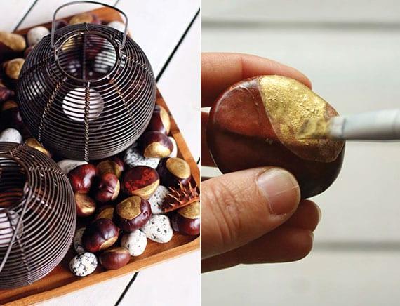 kreatives basteln mit kastanien für coole tischdeko im herbst mit kerzen in schwarzen metallteelichthaltern, weißen kiesesteinen und gold gefärbten kastanien in holztablett