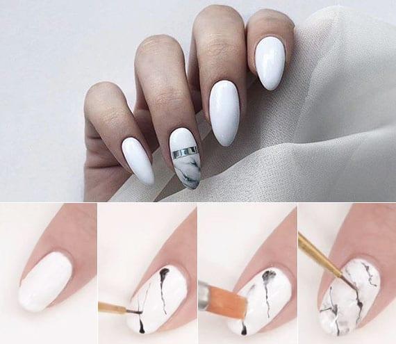 coole gestaltung weiß lackierter fingernägel mit marmor-designtechnik
