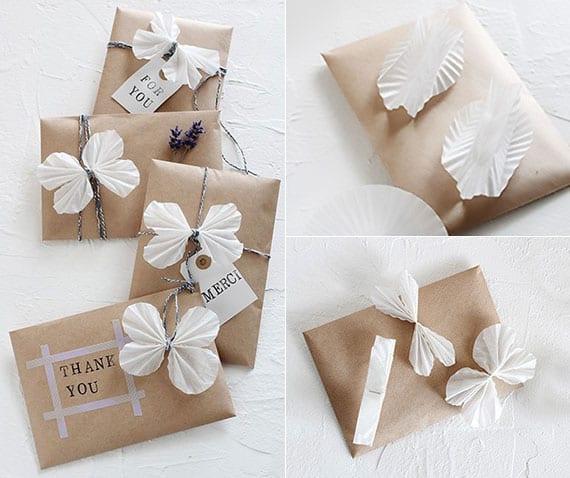 coole und einfache verpackung für geschenke mit weißen schmetterlingen aus muffinförmchen