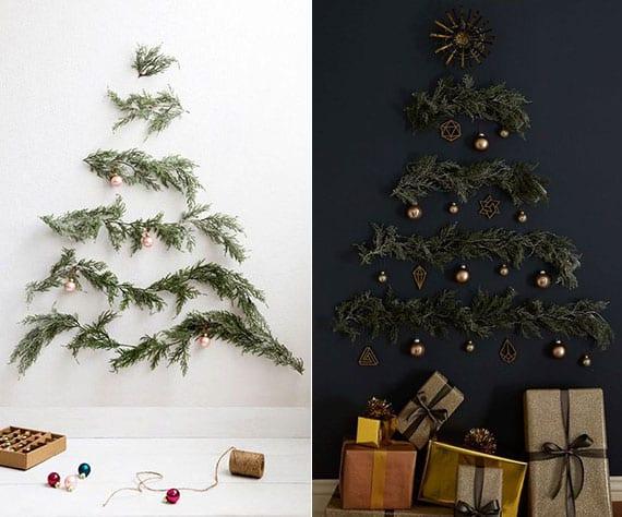 originelle wanddekoideen für weihnachten mit selbstgemachtem weihnachtsbaum aus frischen nadelzweigen mit weihnachtschmuck