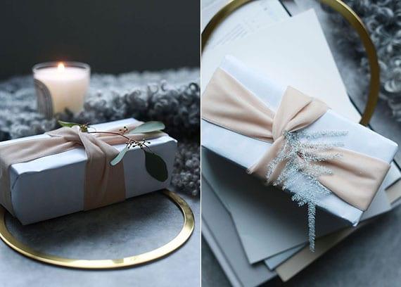 verpackungsideen für geschenke mit weißem papier, breitem stoffband in hellrosa und Eukalyptus