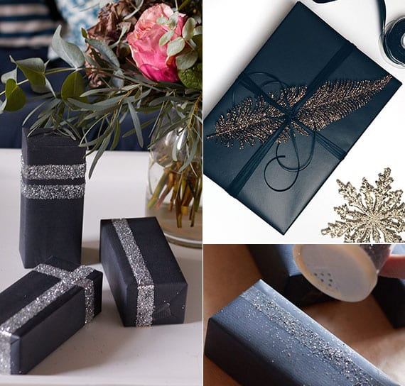 elegante geschenkverpackung schwarz mit streuglitzer in silber und glitzerfeder gold