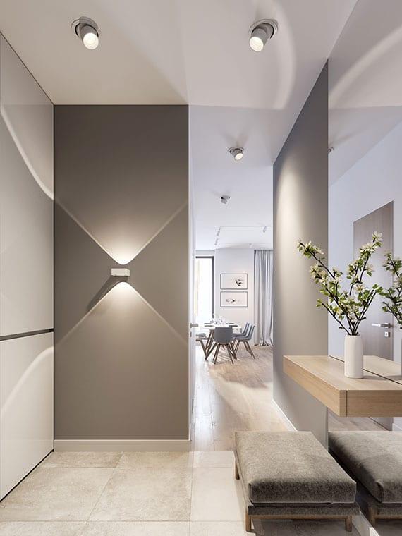 eingangsbereich modern gestalten mit wandfarbe grau, einbaugarderobe weiß, ganzkörperspiegel hinter wandholzregal