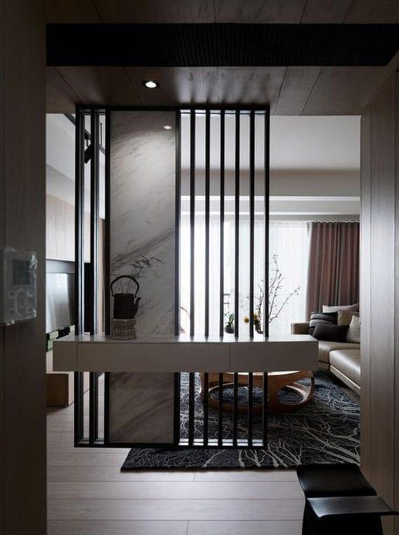 ideen für moderne raumgestaltung kleiner wohnungunen mit dekorativer trennwand und wandregal