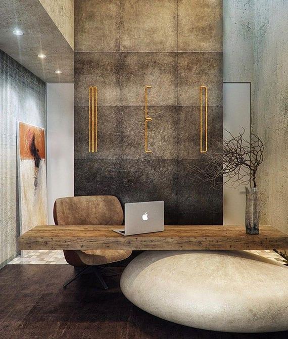 coole gestaltungsidee für modernen büroraum im Zen-Stil mit akentwand aus wandfliesen in stein-optik, betondecke mit einbauleuchten, designer-bürotisch aus holz und großem und bürostuhl lederstein