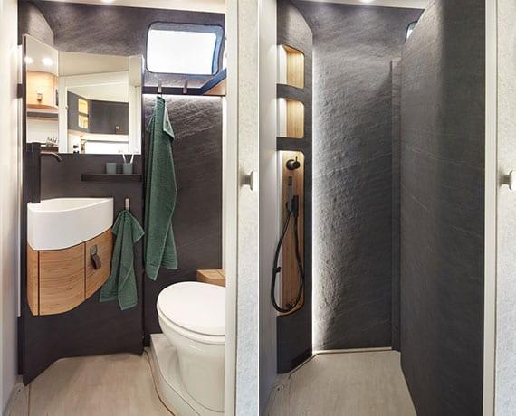 luxuriöses reisemobil-bad mit natursteinwandverkleidung, betonboden und flexibler wand mit badspiegel und eck-waschbecken