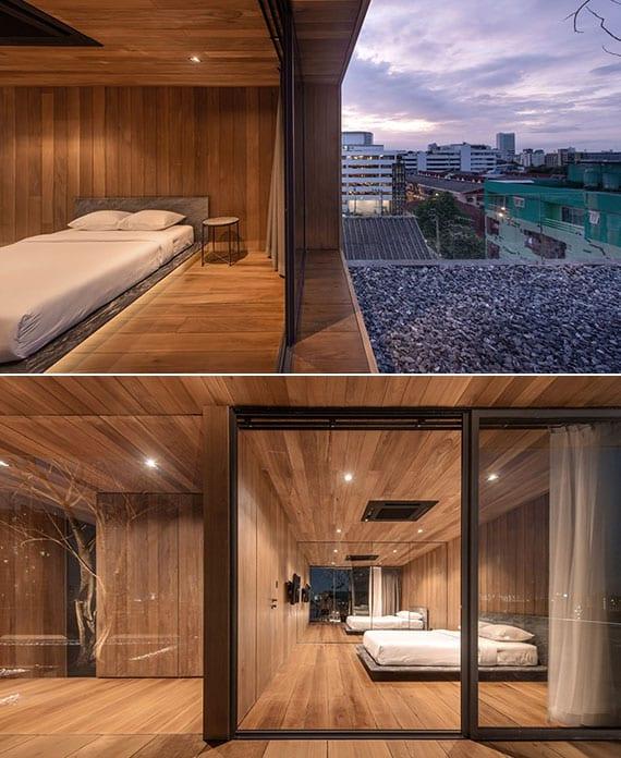 attraktive schlafzimmergestaltung in holz mit schwebett, einbaukleiderschrank mit spiegeltüren und glasschiebetür zur dachterrasse