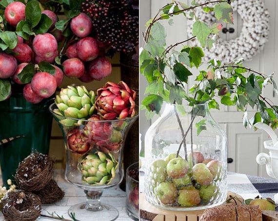 stilvolle tischdekoration mit äpfeln und zweigen im glas in kombination mit beeren und artischocken