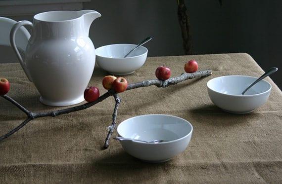 schlichte und moderne tischdeko basteln mit äpfeln und kleinem baumast