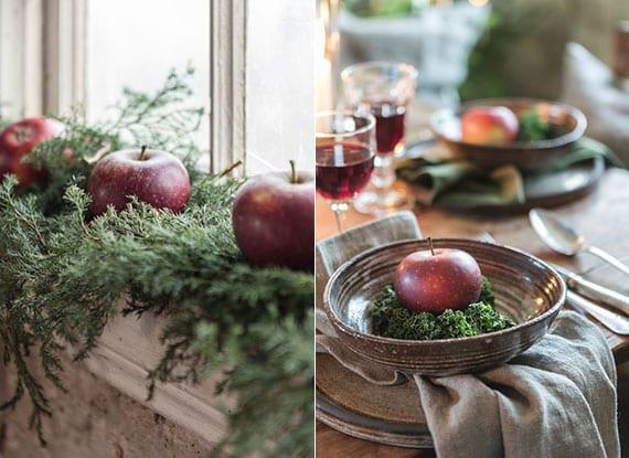 rote äpfel als winterliche fernsterbank deko und festliche platzteller dekoration