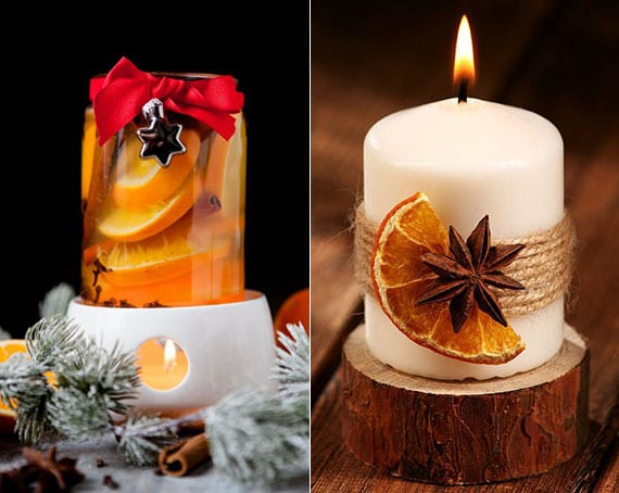 weihnachtsdeko mit diy orangen-raumduft und kerze auf holzscheibe mit getrockneter orangenscheibe und anisstern