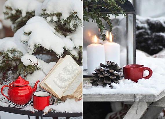 winterliche gartendeko ideen mit roter tasse, buch, zapfen und laterne mit kerzen