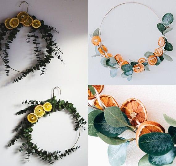 originelle wanddeko mit diy kranz aus draht-kleiderbügel oder metallring, orangenscheiben und eukalyptuszweigen