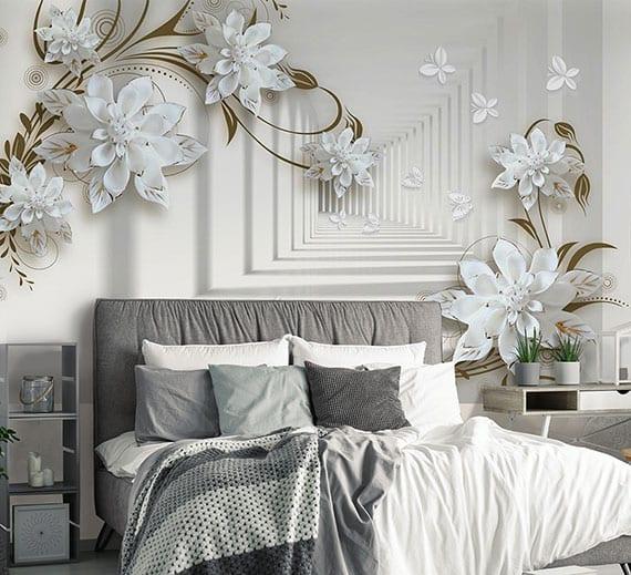 kleines schlafzimmer modern einrichten mit polsterbett in grau und dreidimensionaler säulengang fototapete mit weißen blumen und