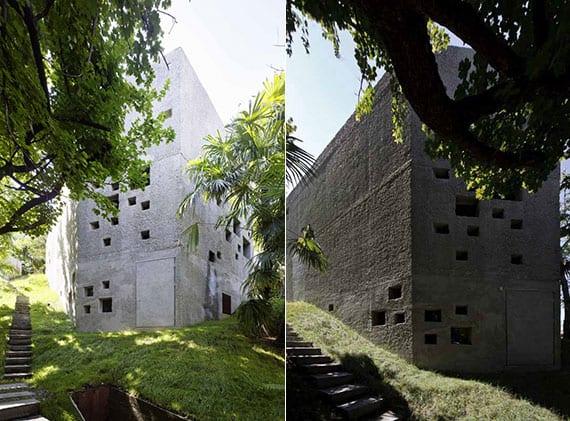 modernes einfamilienhaus in form von turm mit lochfassaden aus beton