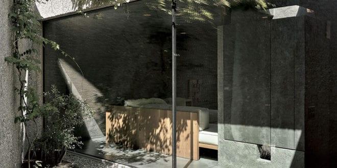 betonbau-in-caviano_dreigeschoßiges–wohnhaus-mit-kleinem-vorgarten
