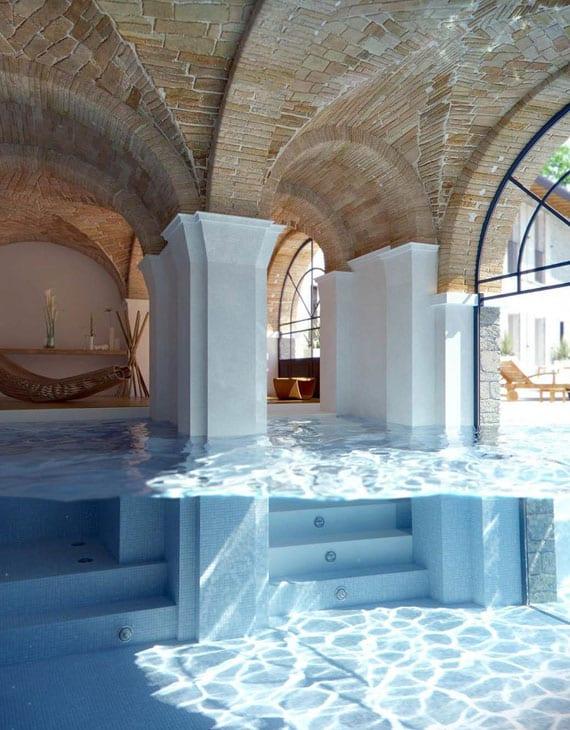 innen- und außenpool in einem_coole visualisierung von einem überdachten schwimmbecken mit säulen im wasser und backsteingewölben