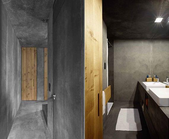 attraktive flur gestaltung und badgestaltung mit raumhohen holztüren und betonwänden