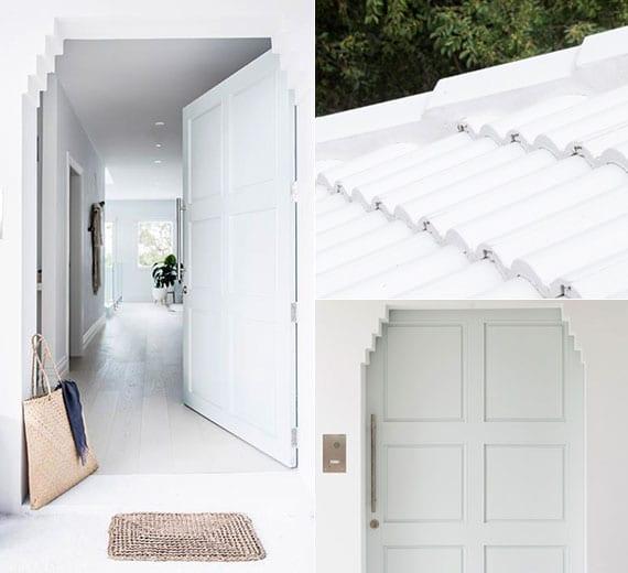 weiße hausfassade akzentuieren durch eine hellgrüne haustür im zackigen rahmen und ergänzen durch ein dach aus weißen dachziegeln