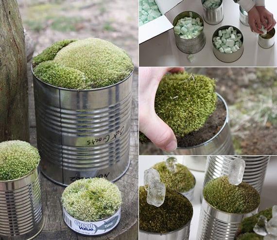 DIY Dekoration mit grünem moos in gebrauchten konservendosen als idee für natürliche tisch- oder zimmerdeko