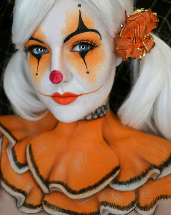 originelle und mutige clown schminke in orange