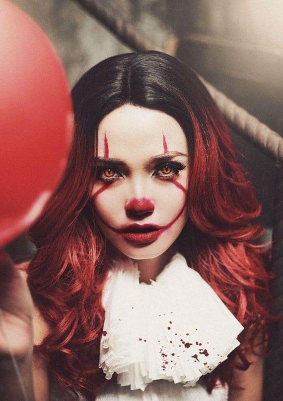 inspiration für weibliche Pennywise Clown Schminke mit gelben Kontanktlinsen für die rothaarigen damen