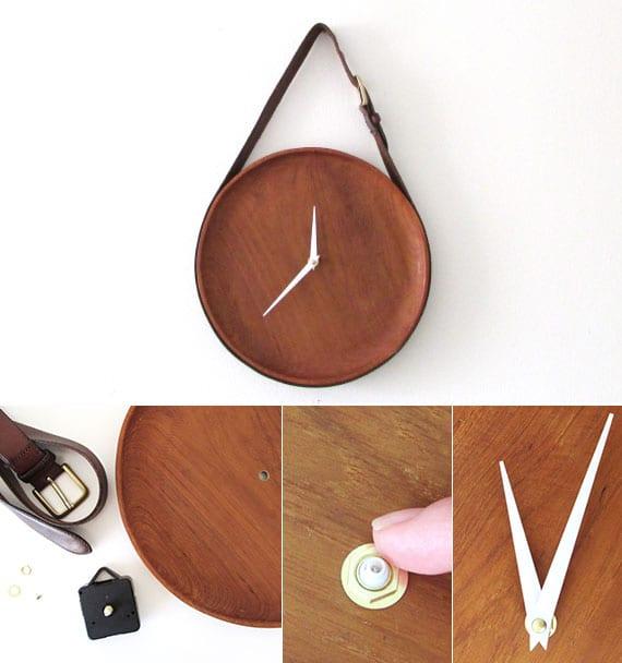 attraktive wanddeko idee mit moderner wanduhr aus teakholzschale und ledergürtel braun