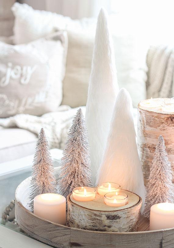 mit kerzenlicht und weißen diy tannenbäumen eine tolle winterdeko zaubern